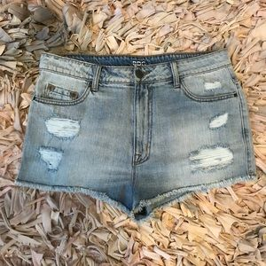 UO BDG Distress High Rise Cheeky Distressed Shorts